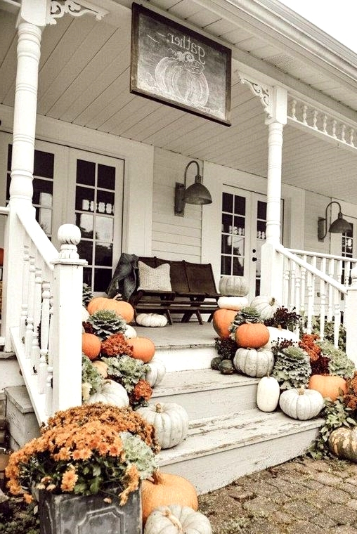 Piles of pumpkins and gourds are perfect for decorating a front porch for fall