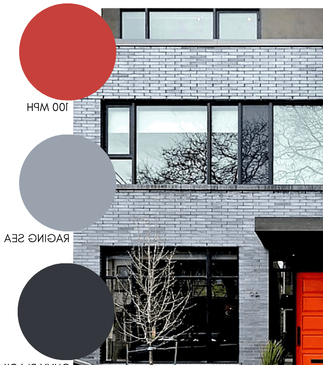 Grey brick with a painted red door. Modern exterior design.