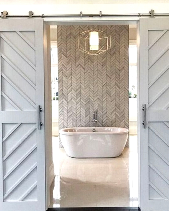 Modern farmhouse bathroom with a herringbone feature wall