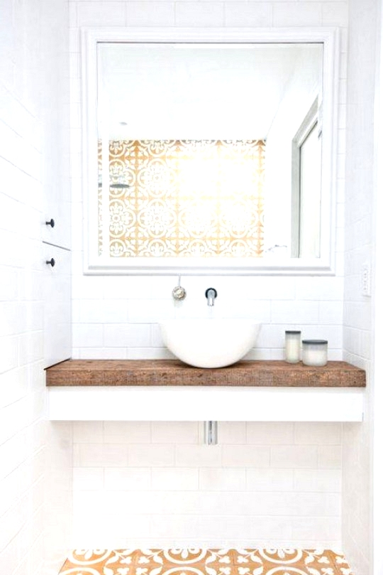 Yellow floor tile in a minimal bathroom