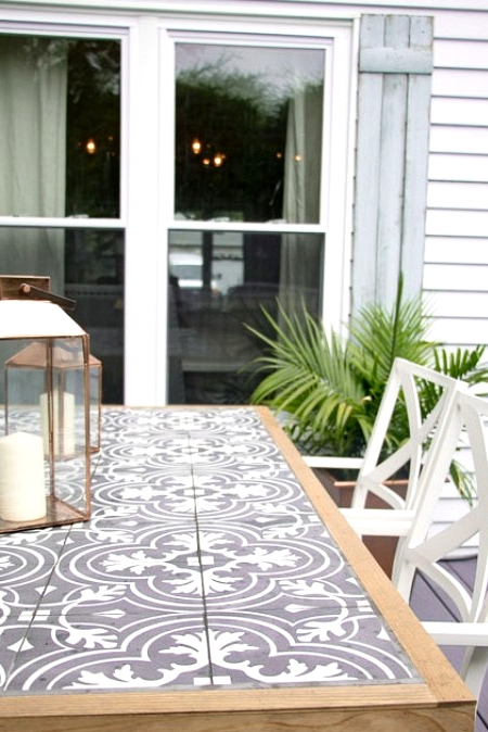 DIY Farmhouse outdoor dining table with a tile top.