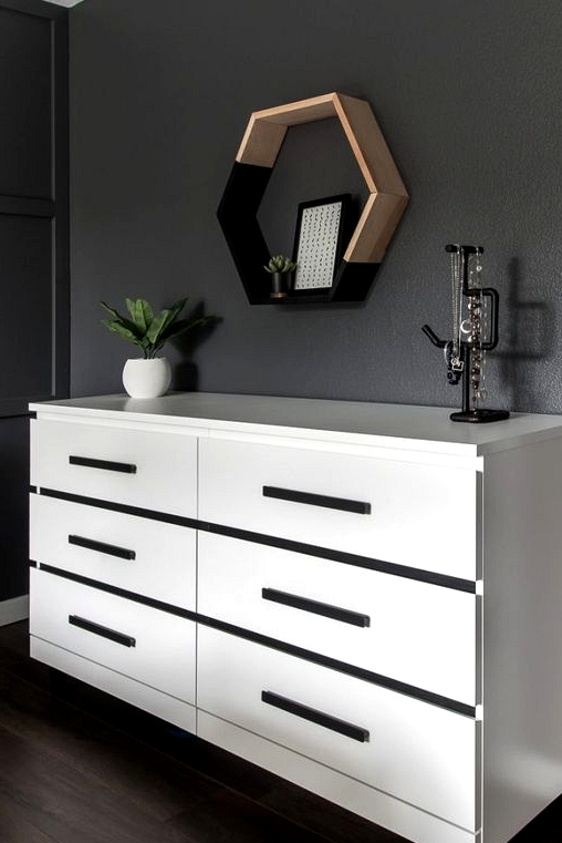 Black and white IKEA dresser hack with custom legs and hardware