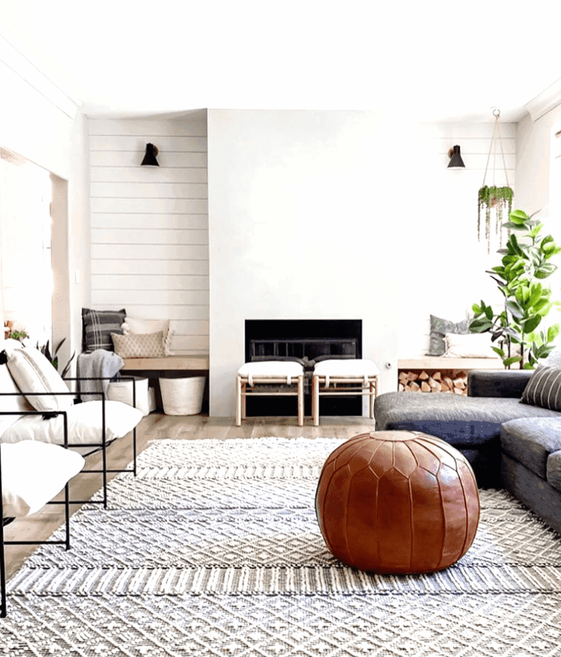 Beautiful modern concrete fireplace paired with shiplap accents walls in this farmhouse inspired living room. Check out this post for more living room inspirations.