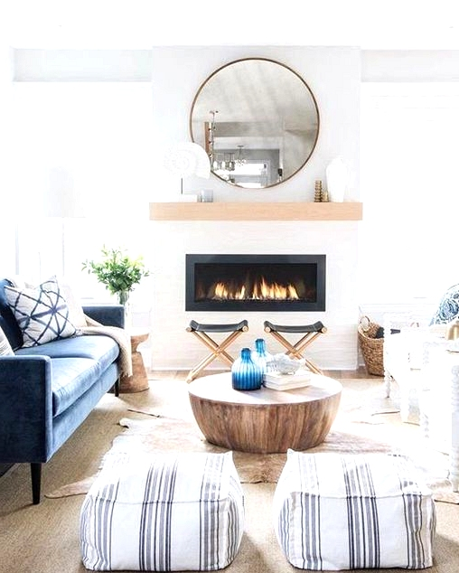 Where coastal meets farmhouse. This coastal modern farmhouse living room is gorgeous. Proof you don't need to follow any rules when it comes to interior design. Check out this post for more modern living room inspirations with a farmhouse twist.