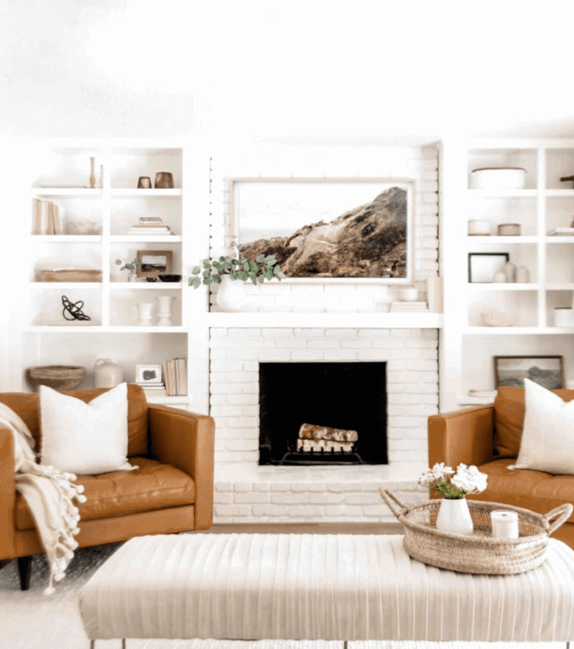 A soft and serene living room with modern farmhouse elements. Check out this post for more farmhouse living room inspirations with a modern twist.