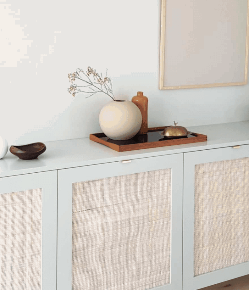 Sophisticated boho chic IKEA cabinet with custom cane door fronts.