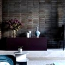 Cool blue and white home with black brick wall for a designer in Melbourne