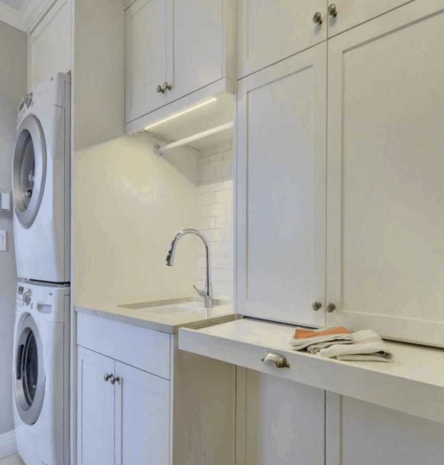 Have an organized laundry room with this pull out folding table. Great tip to increase the function of a small laundry room.