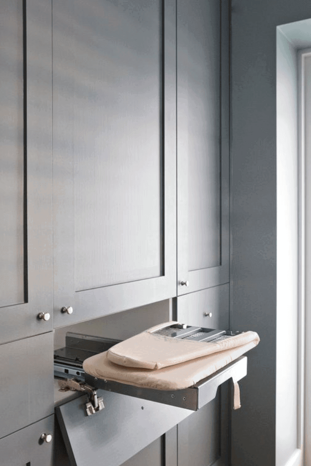 Create the organized laundry of your dreams with a gorgeous pull out ironing board! Check out this plus more laundry room organization tips!