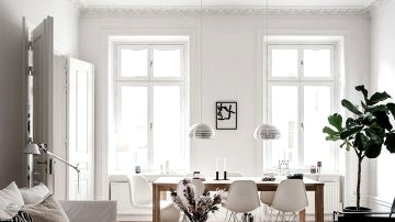 White interiors with mild black accents in Stockholm residence (82 sqm)