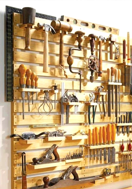#10. WOODEN PALLETS ASSEMBLED INTO A MUTLI-FUNCTIONAL WALL FOR THE GARAGE