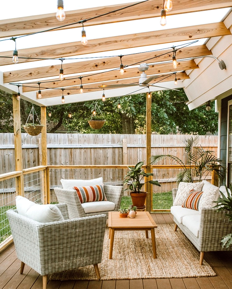 Outdoor design idea with a covered patio and string lights.