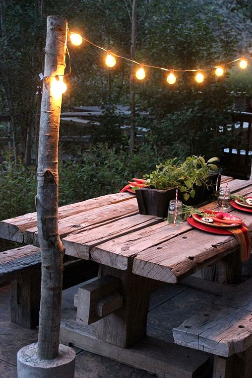 unique string light across a beautiful rustic bench