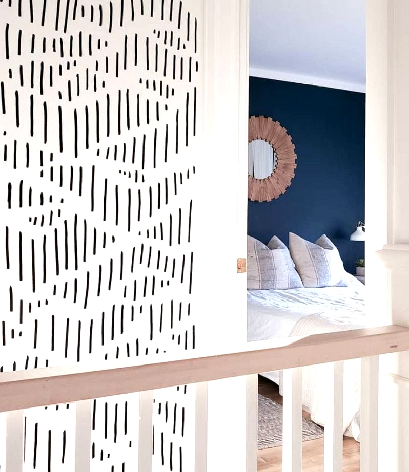 Abstract geometric sharpie wall for an inexpensive home decor project.