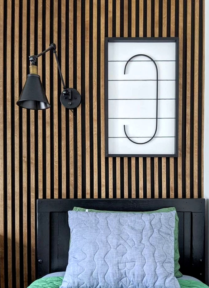 Budget friendly accent wall ideas black and wood slat wall.