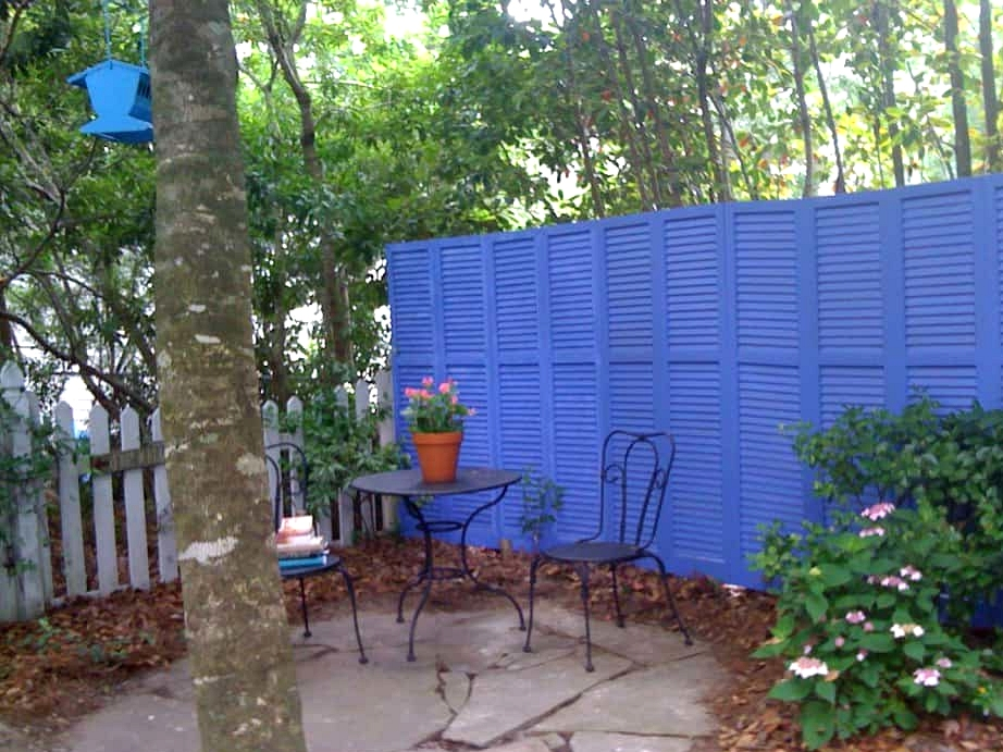Use Old Shutters to Create a Statement Fence