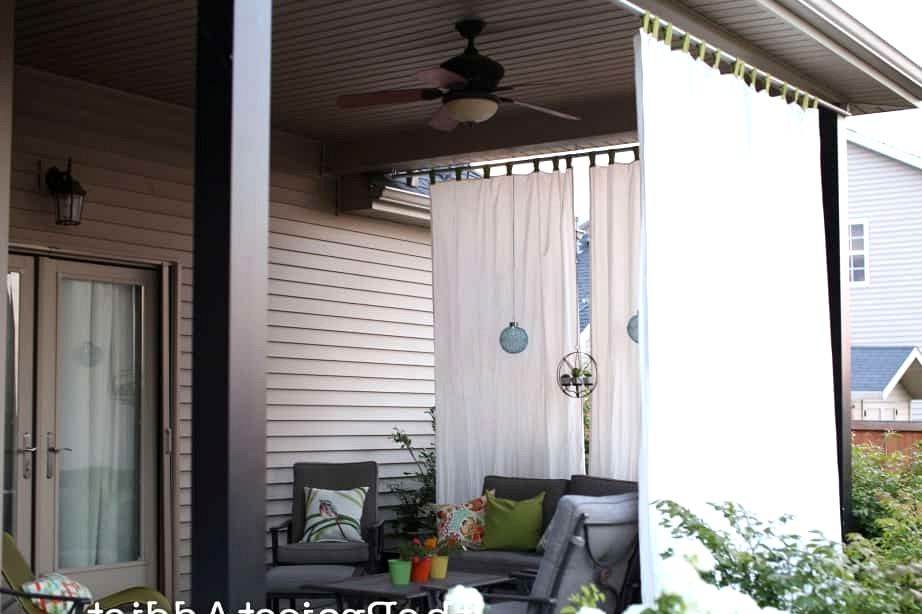 Hang Some Outdoor Curtains Around the Porch