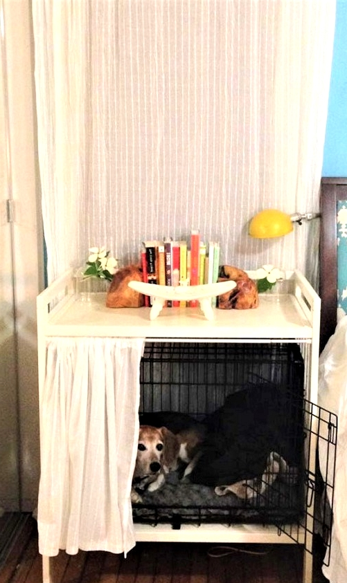 Changing table turned IKEA hack for pets. Great Dog crate storage idea.