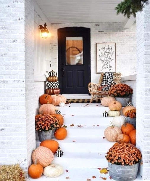 varying shades of orange pumpkins are ideal when creating a classic fall front porch design.