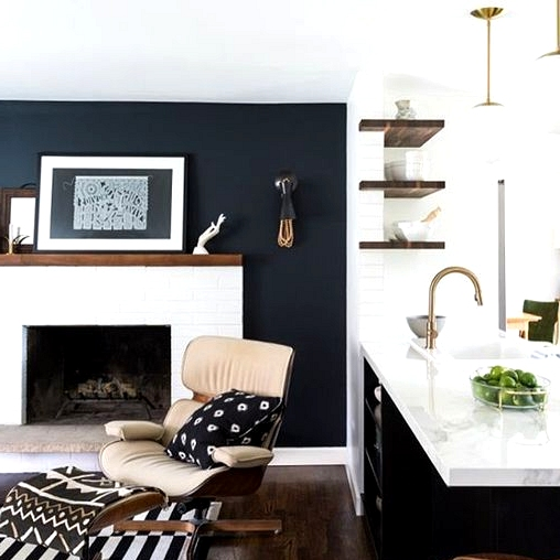 Black living room accent wall with a white brick fireplace