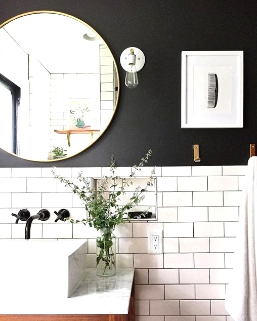 Black grout to match a painted black wall in a farmhouse bathroom