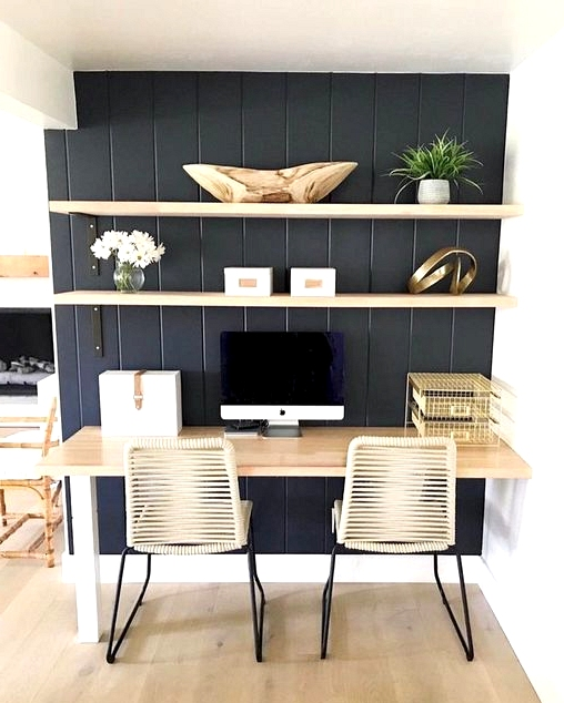 Small corner turned home office with a black accent wall