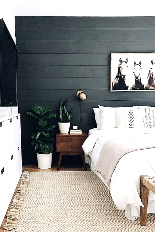Black shiplap accent wall in a neutral bedroom