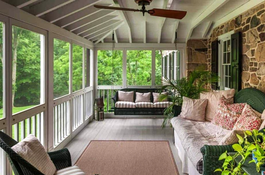 Create a Cozy Cottage Feel with Stone Wall and White Porch