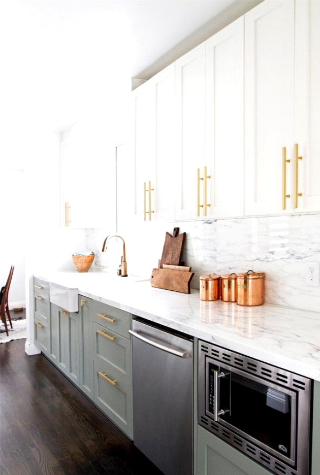In your two toned kitchen I suggest you use the darker of the two colors for your base cabinets. This will help ground your kitchen and is important in creating balance in the kitchen.