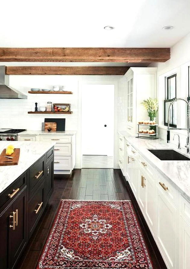 A great way to incorporate the two toned trend in your kitchen is by accenting your kitchen island. If all of your cabinets are one finish, switch things up with a bold color for your island. The island is the heart of the kitchen and a contrasting color will highlight that.