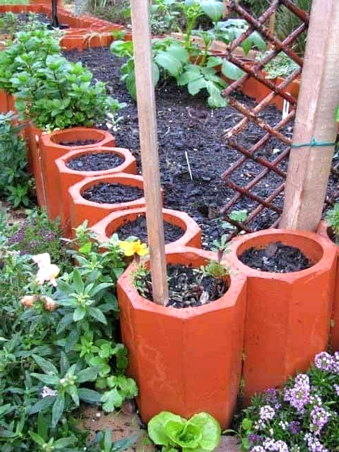 Use Terracotta Pipes for a Border of Planters