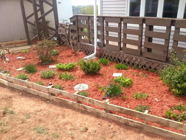 Use Pallets for a Cheap and Simple Fence