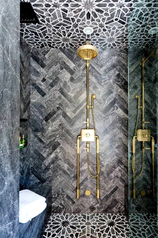 Floor to ceiling marble tile drama in this master bathroom shower