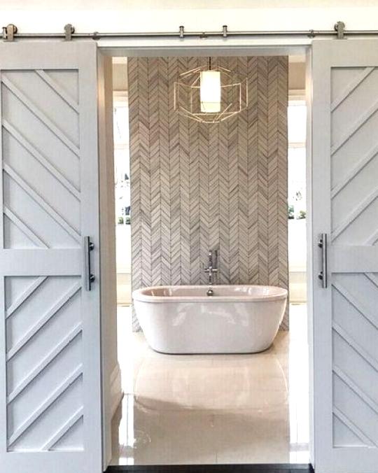 Modern farmhouse bathroom with a herringbone feature wall