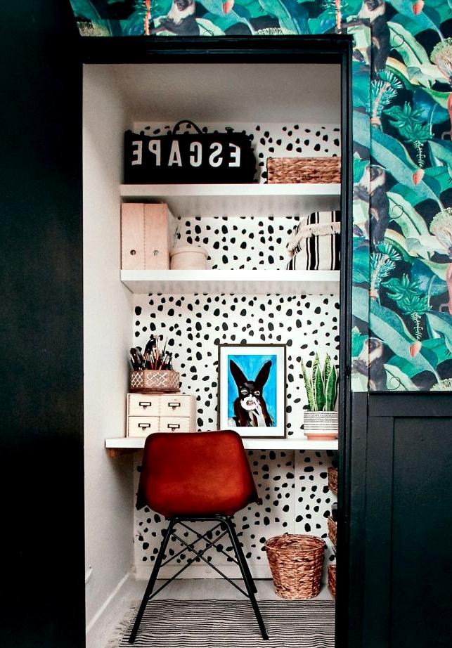 A cute alcove office space in a converted closet.