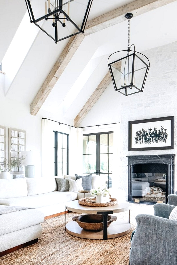 Black accents make this modern farmhouse living room one to remember. check out this post for more modern farmhouse living room inspirations.