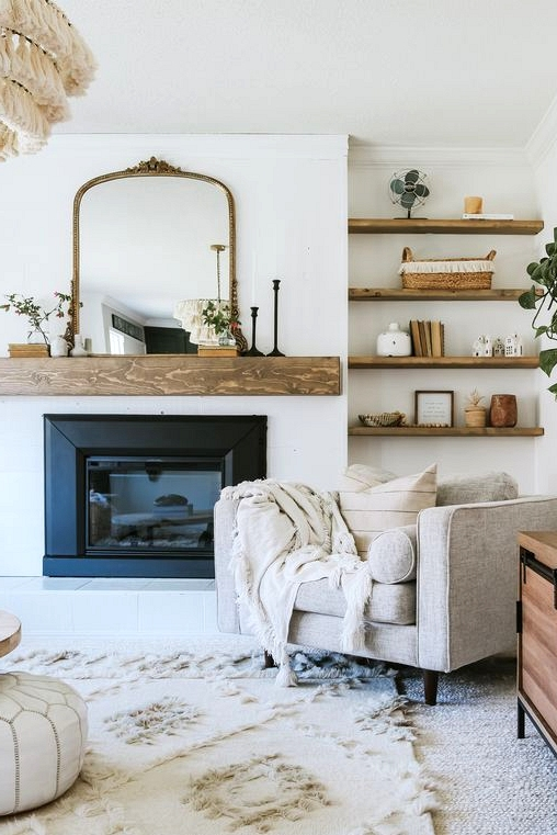 A DIY farmhouse lovers dream. Check out this DIY mantle and more modern farmhouse living room inspirations.