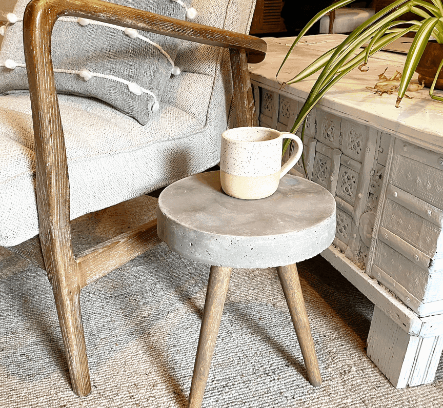 Make your own Mid century modern inspired accent table with concrete top by following this tutorial.