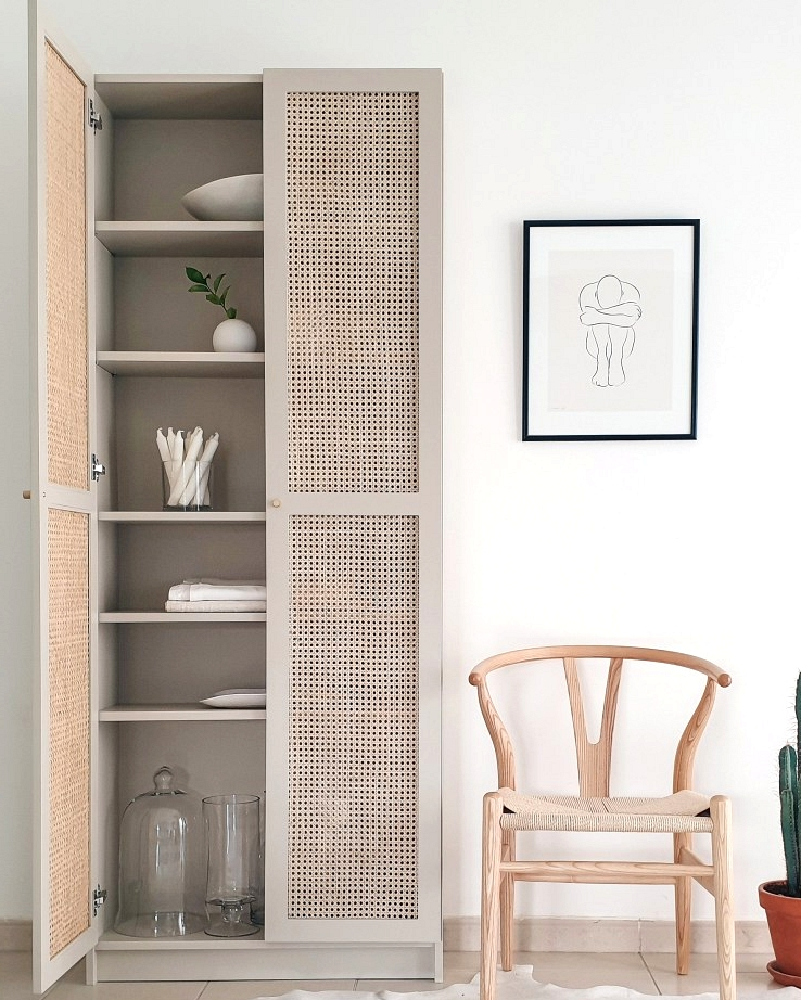Subtle boho vibes and custom rattan door fronts make this IKEA Billy bookcase makeover beautiful.