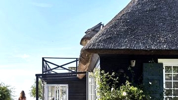 Conventional Danish thatched home proper by the ocean