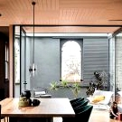 Black, metal and old brickwork: bold home in Australian