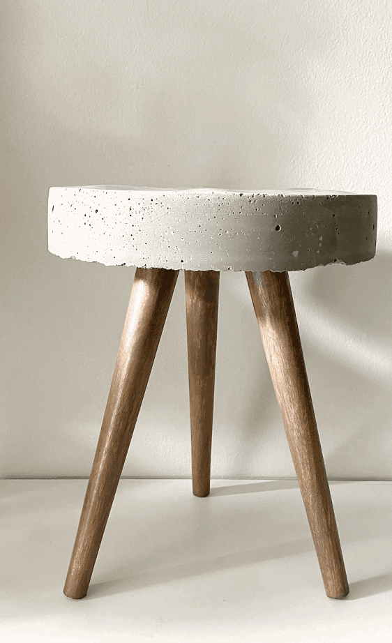 Make this simple DIY concrete side table by following this tutorial!