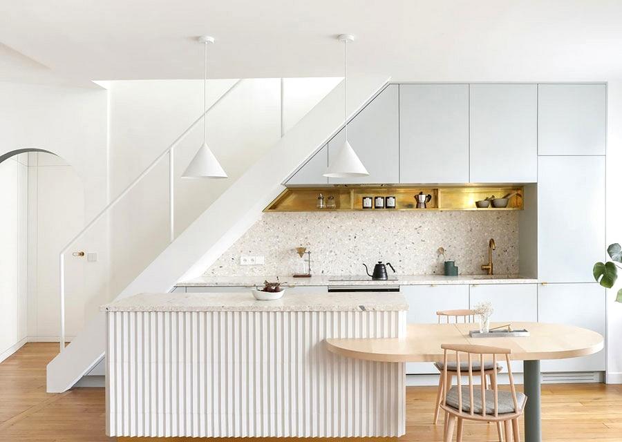 Arches, pastel colours and gold accents: delicate fashionable condominium in Paris