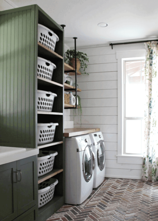 Keep an organized laundry room with tons of basket storage! Check out more tips for laundry room organization in your home.