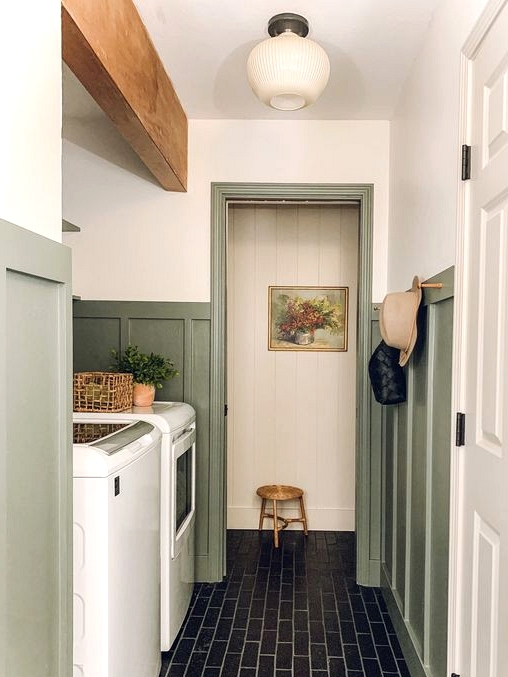Brick flooring and green wainscotting are perfect for this vintage charm laundry room