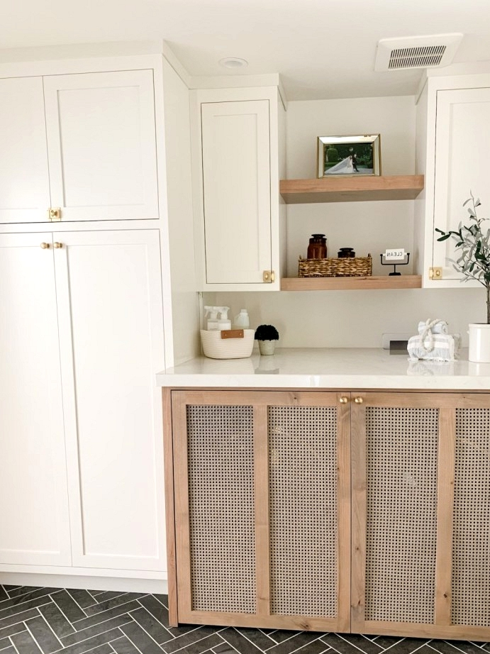 Cane door fronts disguise this washer and dryer in a hallway laundry room.