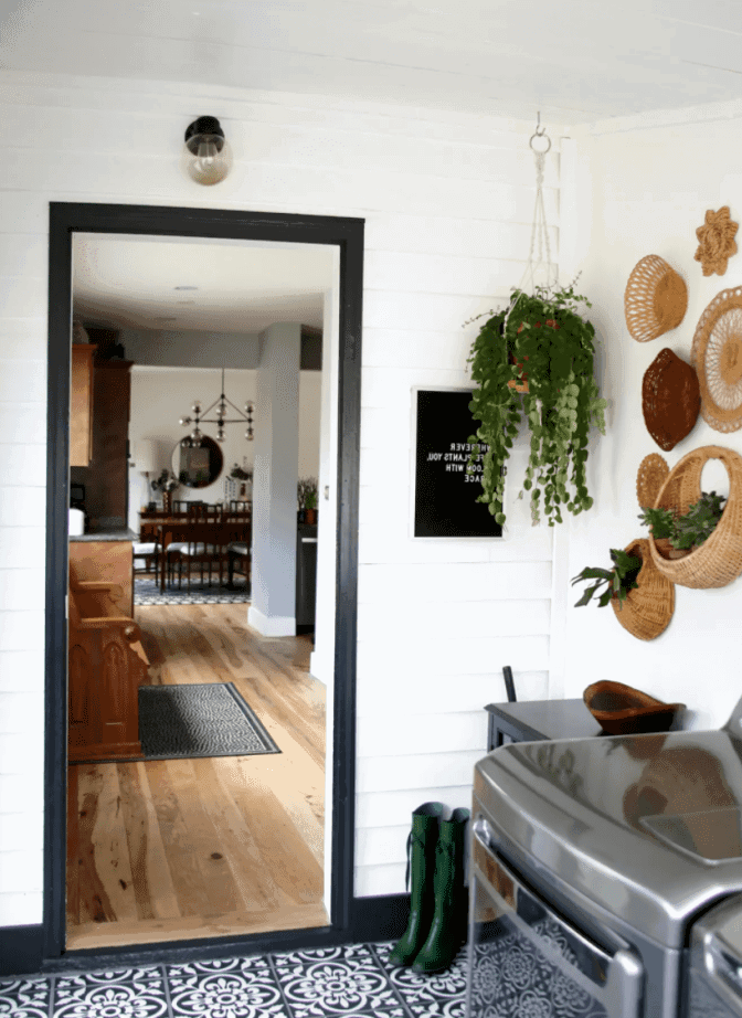black and white farmhouse patterned floor tile laundry room design idea.