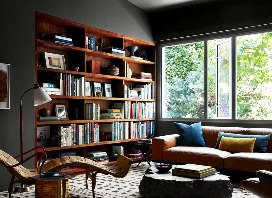 Wood furnishings and decor within the inside of a contemporary dwelling in Los Angeles