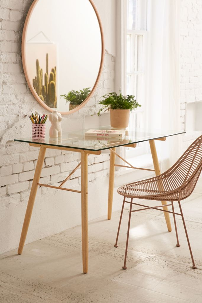A chic glass top desk with elevated rose gold details