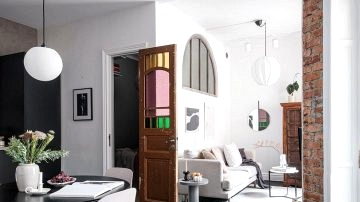 Stained glass door and black ground: uncommon small residence in Sweden (42 sqm)